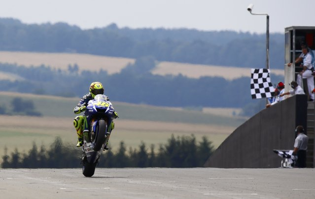 Movistar Yamaha MotoGP rider Valentino Rossi finishes third in the German Grand Prix MotoGP at the Sachsenring circuit in the eastern town of Hohenstein-Ernstthal, Germany, July 12, 2015. (Photo by Hannibal Hanschke/Reuters)