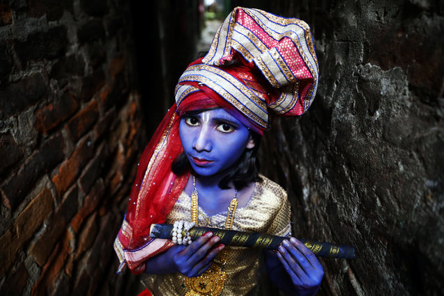 A child dressed as Hindu Lord Krishna poses during the festival of Janmashtami, marking the birth of Hindu Lord Krishna, in Dhaka, Bangladesh, August 23, 2019. (Photo by Mohammad Ponir Hossain/Reuters)