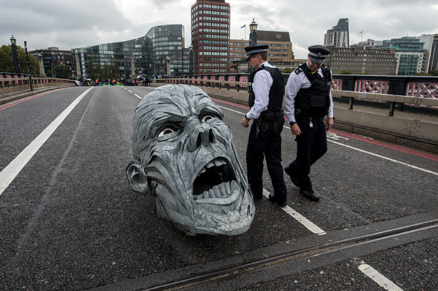 Police remove protest infrastructure on Lambeth Bridge on October 7, 2019 in London, England. Extinction Rebellion occupy several sites around Westminster for two weeks of protest and direct action against climate change. (Photo by Guy Smallman/Getty images)
