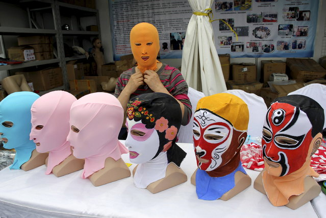 Zhang Shifan tries on a face-kini mask as she demonstrates her products at an exhibition in Qingdao, Shandong province, China, May 22, 2015. (Photo by Reuters/Stringer)