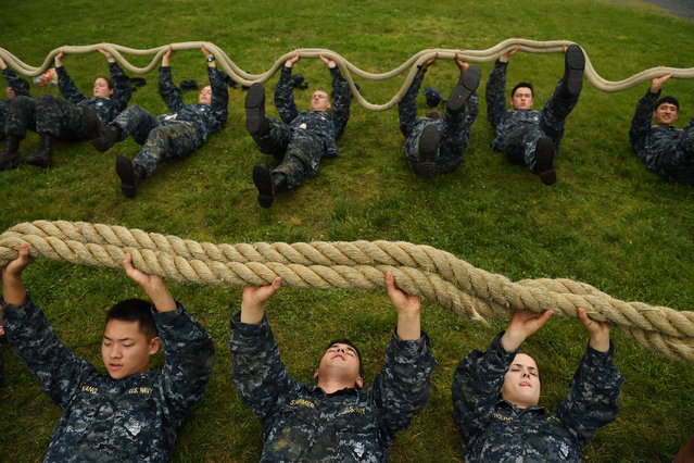 United States Naval Academy plebes, Richard Kang, bottom left to right, Kai Starmer, and Lauren Bartholemy take part in rope pt during Sea Trials at the United States Naval Academy on Tuesday May 17, 2016 in Annapolis, MD. (Photo by Matt McClain/The Washington Post)