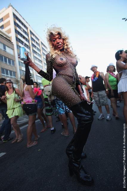 A reveler poses during Carnival celebrations along Ipanema beach in Rio de Janiero