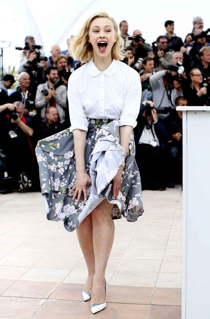 Actress Sarah Gadon reacts as her skirt is blown by the wind as she poses for photographers during a photo call for Maps to the Stars at the 67th international film festival, Cannes, southern France, Monday, May 19, 2014. (Photo by Alastair Grant/AP Photo)