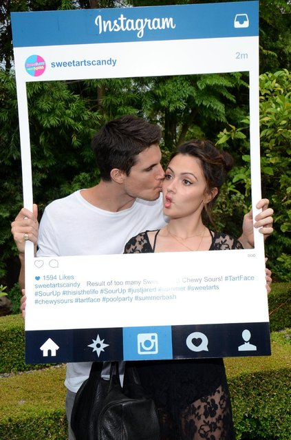 Robbie Amell, left, and Italia Ricci are seen at the Just Jared Summer Party on Saturday, July 18, 2015, in Los Angeles, Calif. (Photo by Tonya Wise/Invision for Just Jared/AP Images)