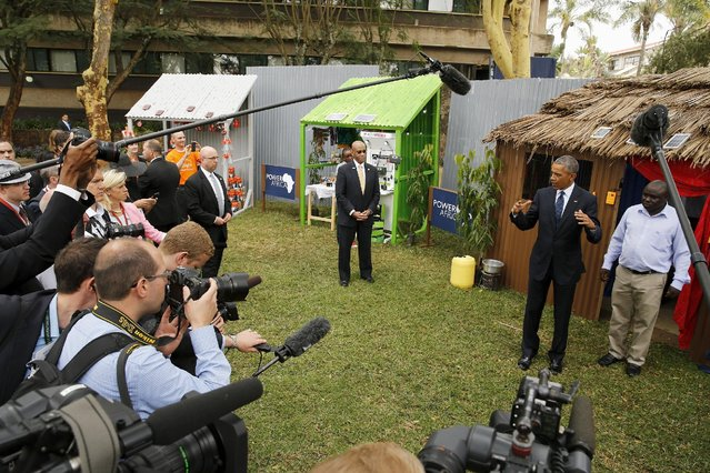 U.S. President Barack Obama (2nd R) addresses the media while talking with solar power businesspeople at the Power Africa Innovation Fair at the United Nations compound in Nairobi, Kenya July 25, 2015. (Photo by Jonathan Ernst/Reuters)