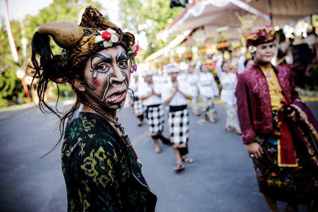 A Balinese artist in costume stands after his art appearance during the opening of the 36th Bali International Arts Festival on June 13, 2014 in Denpasar, Bali, Indonesia. (Photo by Agung Parameswara/Getty Images)