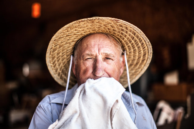 """""""Farmer"""". 79-year-old J.G. wipes sweat from his face after farming in his garden in North Georgia. After retiring from Eastman Kodak in 1990, J.G. started farming weekly on his 15 acre property in Georgia. Though he could make extra money selling the vegetables he grows, he'd rather give it to those in need. Photo location: Free Home, Georgia, USA. (Photo and caption by Branden Camp/National Geographic Photo Contest)"""