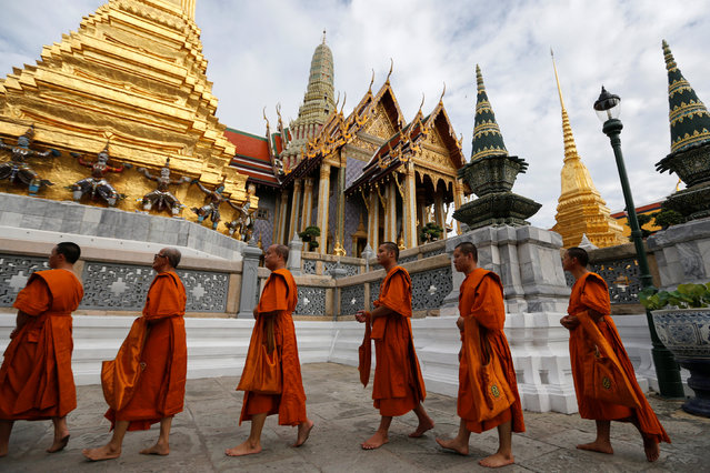 Buddhist monks arrive for a ceremony at the Grand Palace to commemorate Thailand's King Bhumibol Adulyadej's 70th anniversary on the throne, in Bangkok, Thailand June 9, 2016. (Photo by Jorge Silva/Reuters)