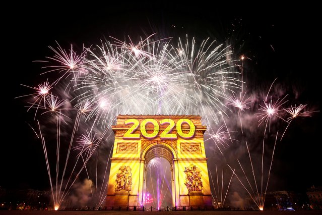 Fireworks illuminate the sky over the Arc de Triomphe during the New Year's celebrations on the Champs Elysees in Paris, France on January 1, 2020. (Photo by Benoit Tessier/Reuters)