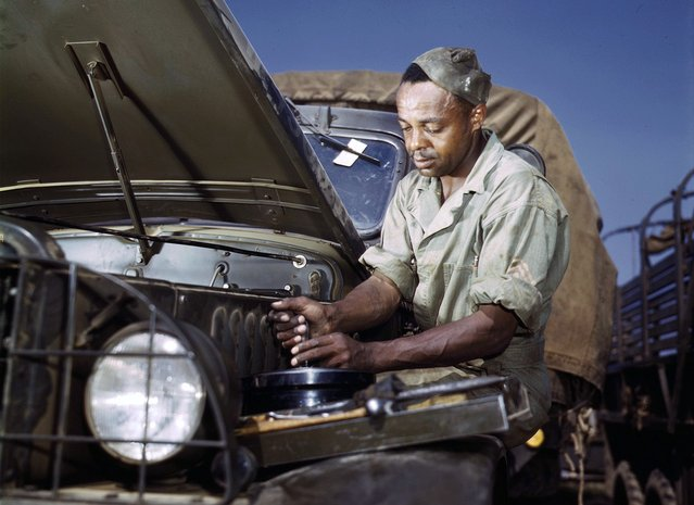 Colored mechanic, motor maintenance section, Ft. Knox, Kentucky. Photographed in June, 1942