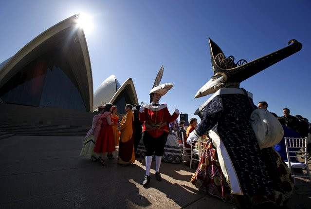 Singers from Opera Australia, dressed in costumes, gather around a banquet table on the forecourt of the Sydney Opera House during a promotional event celebrating the art company's 60th birthday, August 11, 2015. The event also marked Opera Australia's 2016 season launch. (Photo by David Gray/Reuters)