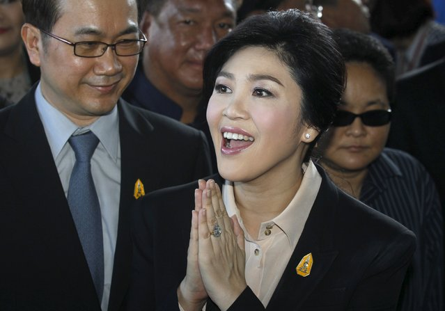 Ousted former Thai Prime Minister Yingluck Shinawatra gestures as she arrives at the Supreme court in Bangkok, Thailand, May 19, 2015. (Photo by Chaiwat Subprasom/Reuters)