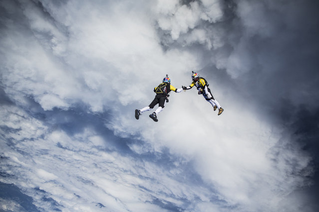 Fred Fugen and Vincent Reffet seen training for a jump over Austria on May 12, 2014. Fearless skydivers jump from an altitude of 10,000 meters above the largest mountain in Europe. Frederic Fugen, 34, and Vincent Reffet, 29, leapt from a plane in the freezing skies above Mont-Blanc in the French Alps. (Photo by Dominique Daher/Barcroft Media)