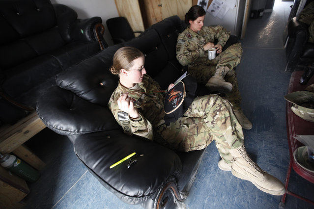 U.S. Army Specialist Nicole Derk of the C Company 3/82 Dustoff MEDEVAC cross-stitches during her shift in Logar province, eastern Afghanistan November 21, 2011. (Photo by Umit Bektas/Reuters)