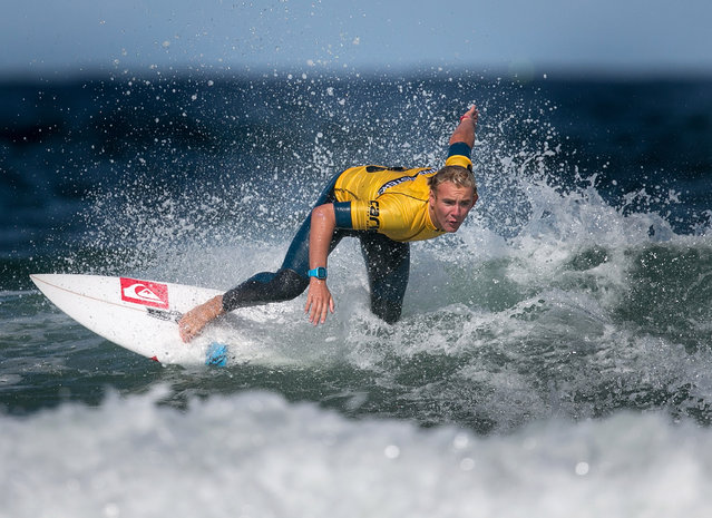 Connor Griffiths from Swansea competes in a heat of the UK Pro Surf Association's Men's Open on Fistral Beach on the second day of the Boardmasters surf and music festival in Newquay on August 7, 2014 in Cornwall, England. (Photo by Matt Cardy/Getty Images)