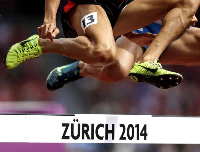 Athletes jump during their 3000m steeplechase heat during the European Athletics Championships in Zurich, Switzerland, Tuesday, August 12, 2014. (Photo by Petr David Josek/AP Photo)