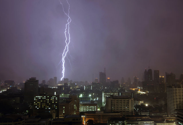 Lightning strikes over Bangkok May 24, 2010. (Photo by Yannis Behrakis/Reuters)