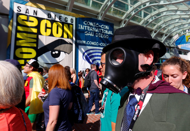 An attendee dressed as Sandman arrives for opening day of the annual Comic-Con International in San Diego, California, United States July 21, 2016. (Photo by Mike Blake/Reuters)