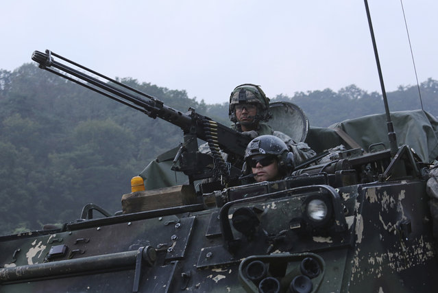 U.S. Army soldiers from the 2nd Infantry Division's the 2nd Armored Brigade Combat Team ride an armored vehicle during a joint military exercise between the U.S. and South Korea at the Rodriquez Multi-Purpose Range Complex in Pocheon, South Korea, Tuesday, September 19, 2017. The U.S. military flew advanced bombers and stealth jets over the Korean Peninsula and near Japan in drills with South Korean and Japanese warplanes on Monday, three days after North Korea fired a missile over Japan. (Photo by Ahn Young-joon/AP Photo)