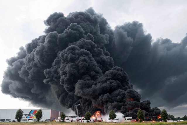 Thick smoke spreads over a burning Styrofoam site while firefighters attempt to put it out in Wittenberge, Germany, 27 July 2016. According to initial information, no one was injured in the factory from Austrian insulation company Austrotherm. Lightning set the giant Styrofoam site on fire and caused millions of euros worth of damage. (Photo by Jens Wegner/EPA)