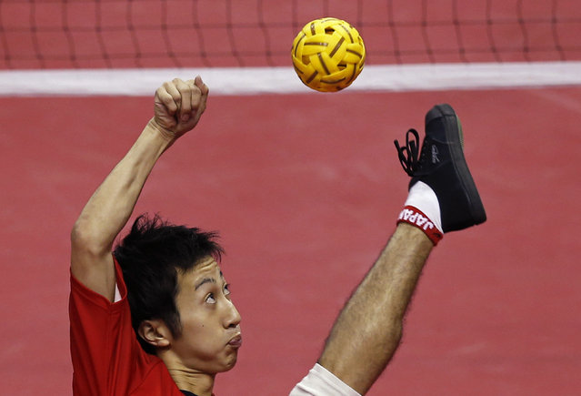Japan's Masayuki Ishizuka strikes the ball against South Korea during their men's team sepaktakraw game at the Bucheon Gymnasium during the 17th Asian Games in Incheon September 24, 2014. Photo by Issei Kato/Reuters)