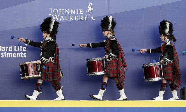 Members of the Vale of Atholl pipe band march off the stage during the opening ceremony of the 40th Ryder Cup at Gleneagles in Scotland September 25, 2014. (Photo by Russell Cheyne/Reuters)