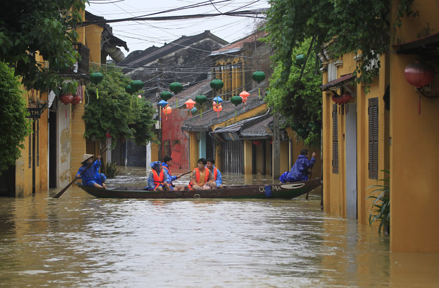 People ride a boat in flooded street in Hoi An, Vietnam, Monday, November 6, 2017. (Photo by Hau Dinh/AP Photo)