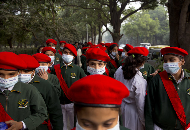 School children take out a march to express their distress on the alarming levels of pollution in the city, in New Delhi, India, Wednesday, November 15, 2017. (Photo by Manish Swarup/AP Photo)