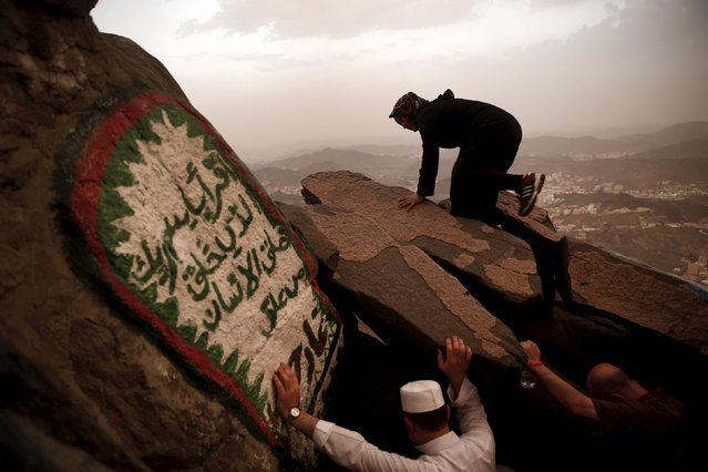 A Muslim pilgrim climbs up the Hera cave, where Muslims believe Prophet Mohammad received the first words of the Koran through Gabriel, at the top of Mount Al-Noor during the annual haj pilgrimage in the holy city of Mecca, September 21, 2015. (Photo by Ahmad Masood/Reuters)