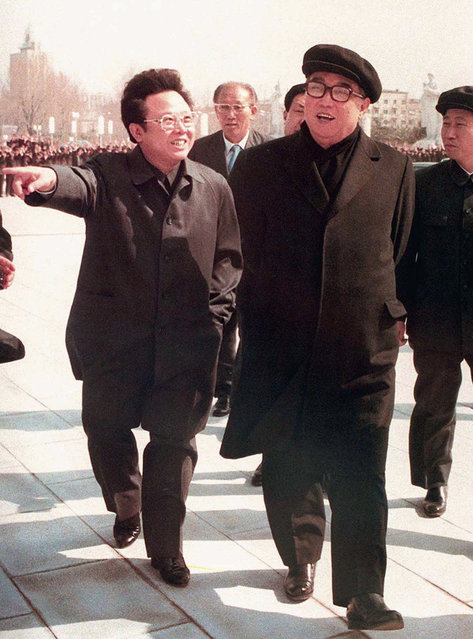 In this April 1981 file photo, the late North Korean leader Kim Jong Il gestures while taking a stroll with the late his father, Kim Il Sung, right, in Pyongyang, North Korea.  When Kim Jong Un took the helm of North Korea in late 2011, speculation swirled around the young leader. What would he do for an economically backward authoritarian nation in a high-stakes nuclear standoff with its neighbors and Washington? Almost six years later, his rule has actually seen the economy improve, and when it comes to the nuclear drive, it's obvious that Kim Jong Un, who rattled nerves last week by test-firing his country's first intercontinental ballistic missile, has a more uncompromising stance than his late father, Kim Jong Il. (Photo by Kyodo News via AP Photo)