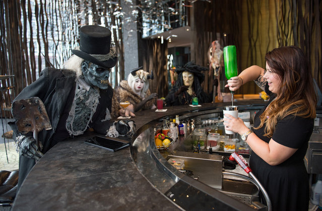 Monsters from Netherworld Haunted House (from left)  The Collector, Crampus and the Crampus Queen at Living Room at W Atlanta Downtown hotel on Thursday, October 7, 2014. (Photo by Hyosub Shin/AJC)