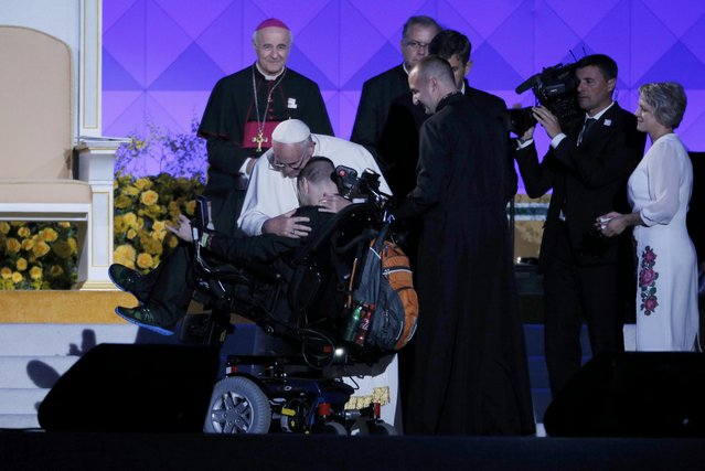 Pope Francis embraces a man in a wheelchair after A Ukranian couple told him the story of their handicapped son as the pontiff attends the Festival of Families in Philadelphia, Pennsylvania September 26, 2015. (Photo by Brian Snyder/Reuters)