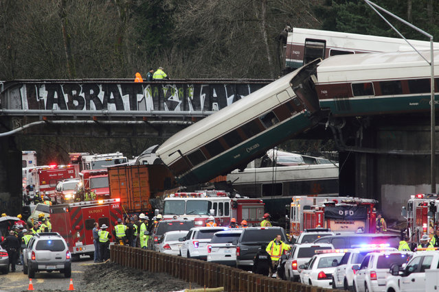 First responders are at the scene of an Amtrak passenger train which derailed and is hanging from a bridge over the interstate highway (I-5) in DuPont, Washington, U.S., December 18, 2017. (Photo by Nick Adams/Reuters)