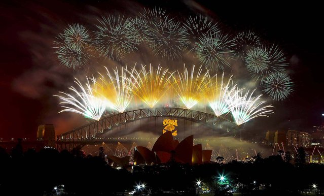 Fireworks explode above Sydney Harbour during celebrations in Sydney, Australia. (Photo by Rob Griffith/Associated Press)