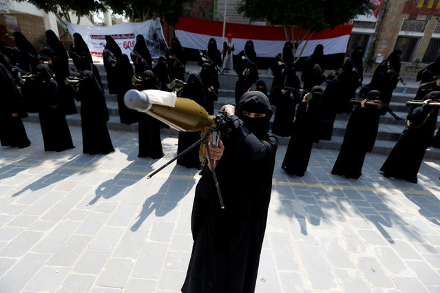 A woman loyal to the Houthi movement hold an RPG weapon as she takes part in a parade to show support for the movement in Sanaa, Yemen September 6, 2016. (Photo by Khaled Abdullah/Reuters)