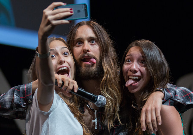 "Jared Leto poses with fans for a selfie during the ""Clear Channel Media and Entertainment"" at the 2014 Cannes Lions on June 18, 2014 in Cannes, France. (Photo by Didier Baverel/WireImage)"