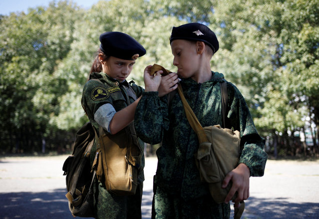Fifth-grade students of the General Yermolov Cadet School get prepared before their first military tactical exercise on the ground, which includes radiation resistance classes, forest survival studies and other activities, in Stavropol, Russia, September 10, 2016. Picture taken September 10, 2016. (Photo by Eduard Korniyenko/Reuters)
