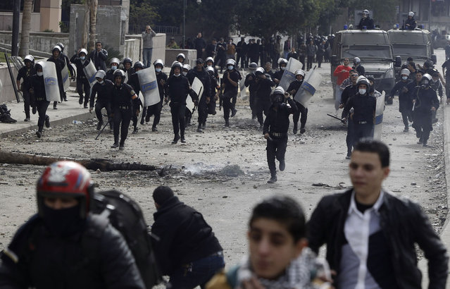 Riot police run towards protesters opposing Egyptian President Morsi during clashes, along Qasr Al Nil bridge, which leads to Tahrir Square, on January 28, 2013. Monday was the fifth day of violence in Egypt that has killed 50 people and prompted the Islamist president to declare a state of emergency in an attempt to end a wave of unrest sweeping the Arab world's biggest nation. (Photo by Amr Abdallah Dalsh/Reuters/The Atlantic)