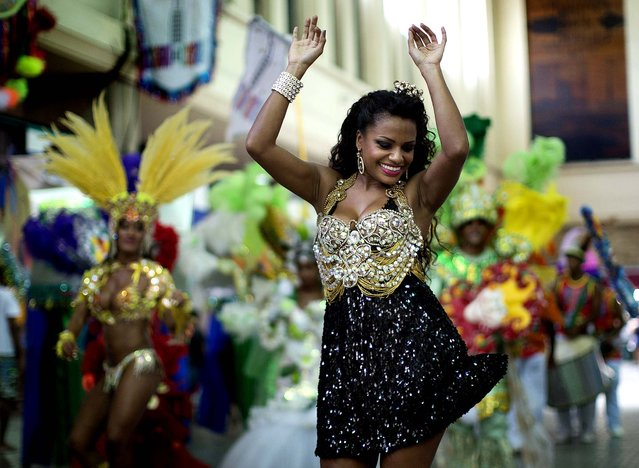 """A woman dances at the """"Carnaval na Central"""" carnival block party. (Photo by Felipe Dana/Associated Press)"""
