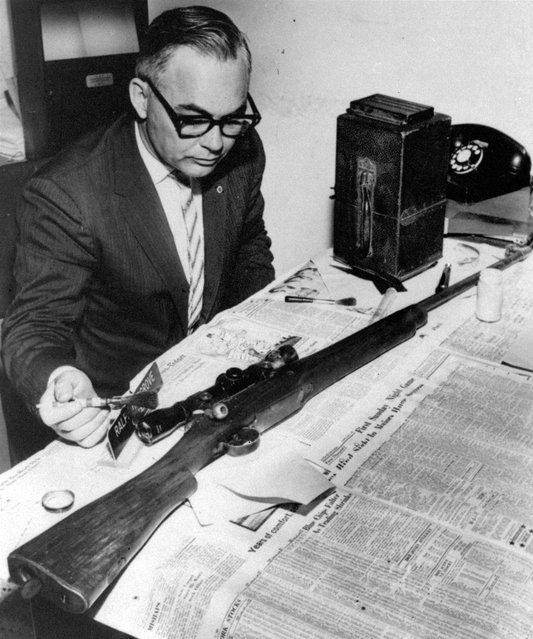 In this June 12, 1963 file photo, Jackson Police Capt. Ralph Hargrove, chief of the Identification Bureau, poses with .30 caliber rifle which police say was used to kill Medgar Evers. Evers was field secretary for the NAACP and was shot at his Jackson, Miss. home. The weapon was found in some weeds nearby. (Photo by AFP Photo)