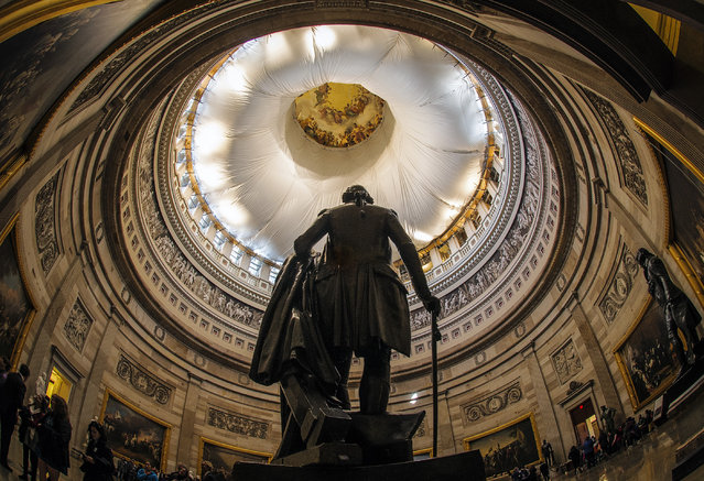 The Architect of the Capitol briefs assembled press on the progress of the U.S. Capitol Dome Restoration Project on November, 18, 2014 in Washington, DC. Pictured, a view of the interior of the Rotunda, showing the protection beneath the dome during construction.  (Photo by Bill O'Leary/The Washington Post)