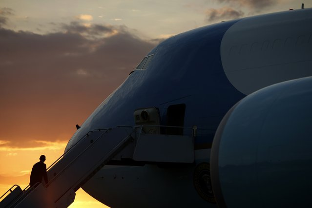 U.S. President Barack Obama climbs the steps of Air Force One as the sun sets in Yangon, Myanmar November 14, 2014. Obama is flying overnight to Brisbane, Australia for the G20 Summit. (Photo by Kevin Lamarque/Reuters)