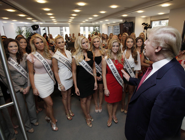 Donald Trump addresses Miss USA contestants in a conference room in Trump Tower, during their to New York, Wednesday, May 25, 2011. (Photo by Richard Drew/AP Photo)