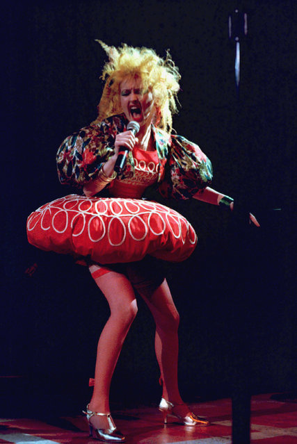 Singer Cyndi Lauper performs at the Madison Square Garden during a benefit concert for the needy of New York City, sponsored by a local radio station, December 20, 1986. (Photo by Corey Struller/AP Photo)