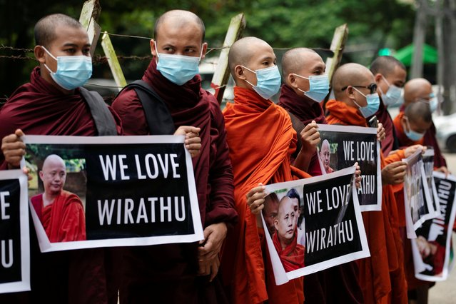 Supporters of a nationalist Buddhist monk Wirathu demonstrate outside the court after he handed himself over to police, in Yangon, Myanmar on November 3, 2020. (Photo by Shwe Paw Mya Tin/Reuters)