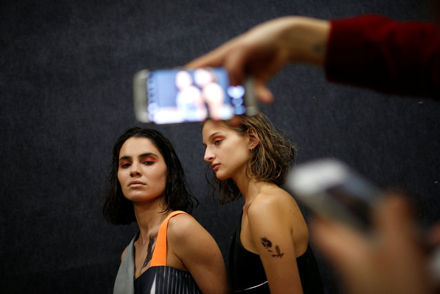 Models pose for picture backstage at the Tbilisi Fashion Week in Tbilisi, Georgia, October 21, 2016. (Photo by David Mdzinarishvili/Reuters)
