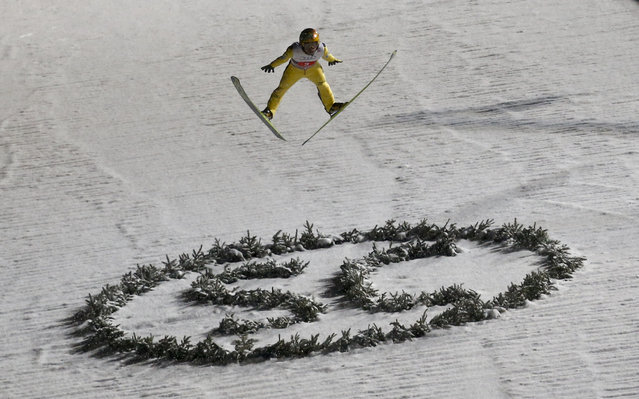 Noriaki Kasai from Japan soars through the air during the first round for the first jumping of the 63rd four-hills ski jumping tournament in Oberstdorf, southern Germany, December 29, 2014. The prestigious four-hills tournament started in Oberstdorf and will end in Bischofshofen on January 6. (Photo by Michael Dalder/Reuters)