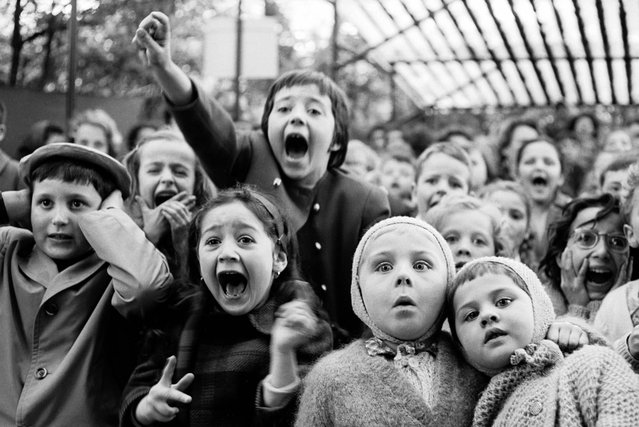 "Children watch the story of ""Saint George and the Dragon"" at an outdoor puppet theater in Paris, in 1963. (Photo by Alfred Eisenstaedt/Time & Life Pictures)"