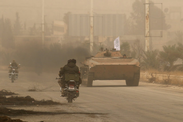 Rebel fighters drive a military vehicle and ride motorcycles in Dahiyat al-Assad, west Aleppo city, Syria October 28, 2016. (Photo by Ammar Abdullah/Reuters)