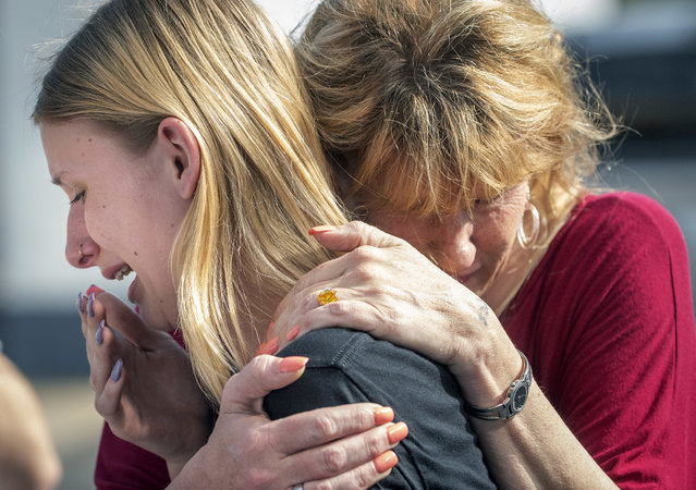 Santa Fe High School student Dakota Shrader is comforted by her mother Susan Davidson following a shooting at the school on Friday, May 18, 2018, in Santa Fe, Texas. Shrader said her friend was shot in the incident. (Photo by Stuart Villanueva/The Galveston County Daily News via AP Photo)